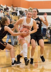 Waverly's Zoiee Smith drives in the lane during a game against Wheelersburg during the 2018-19 season.