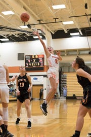 Senior Kami Knight makes a jump shot to score for the Tigers against Wheelersburg Tuesday night at Waverly High School.