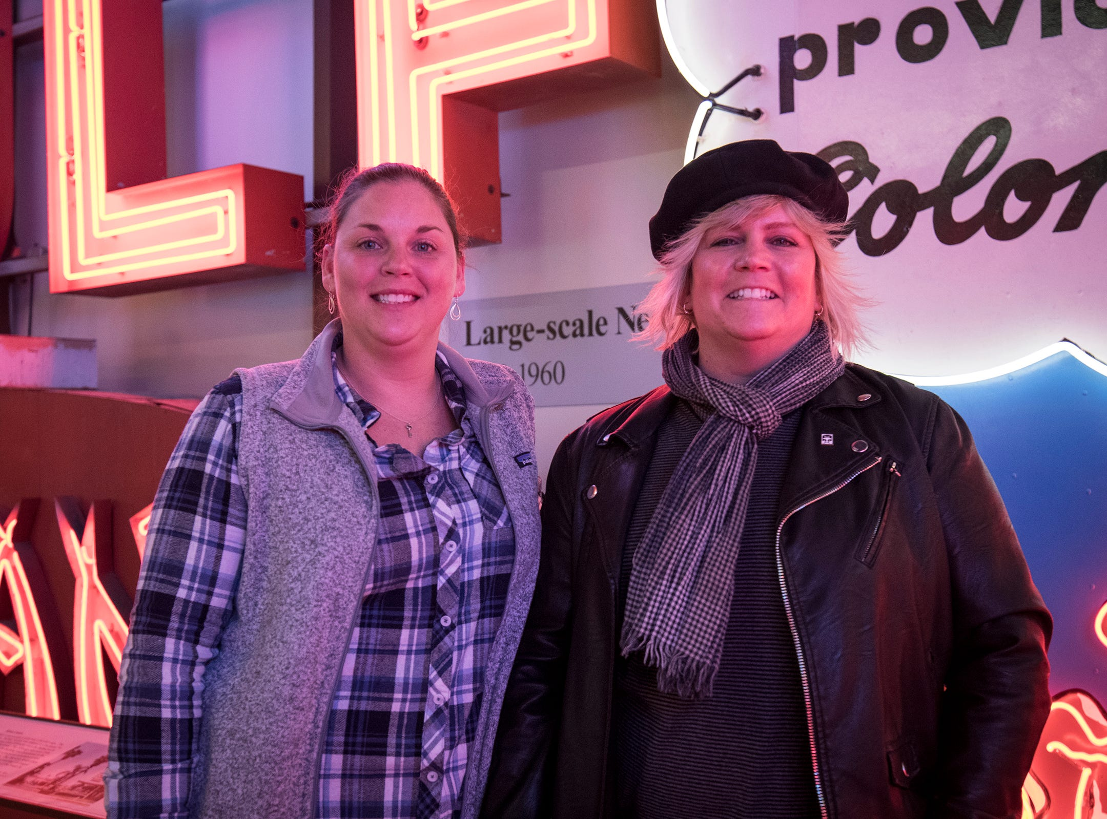 Jessica Back and Holly Harmon of West Chester attend Signs and Suds, featuring Rhinegeist beers at the American Sign Museum Thursday, January 24, 2019 in Cincinnati, Ohio.