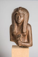 "A bust of a new kingdom queen is part of ""Egypt: The Time of the Pharaohs"" exhibition at the Cincinnati Museum Center."