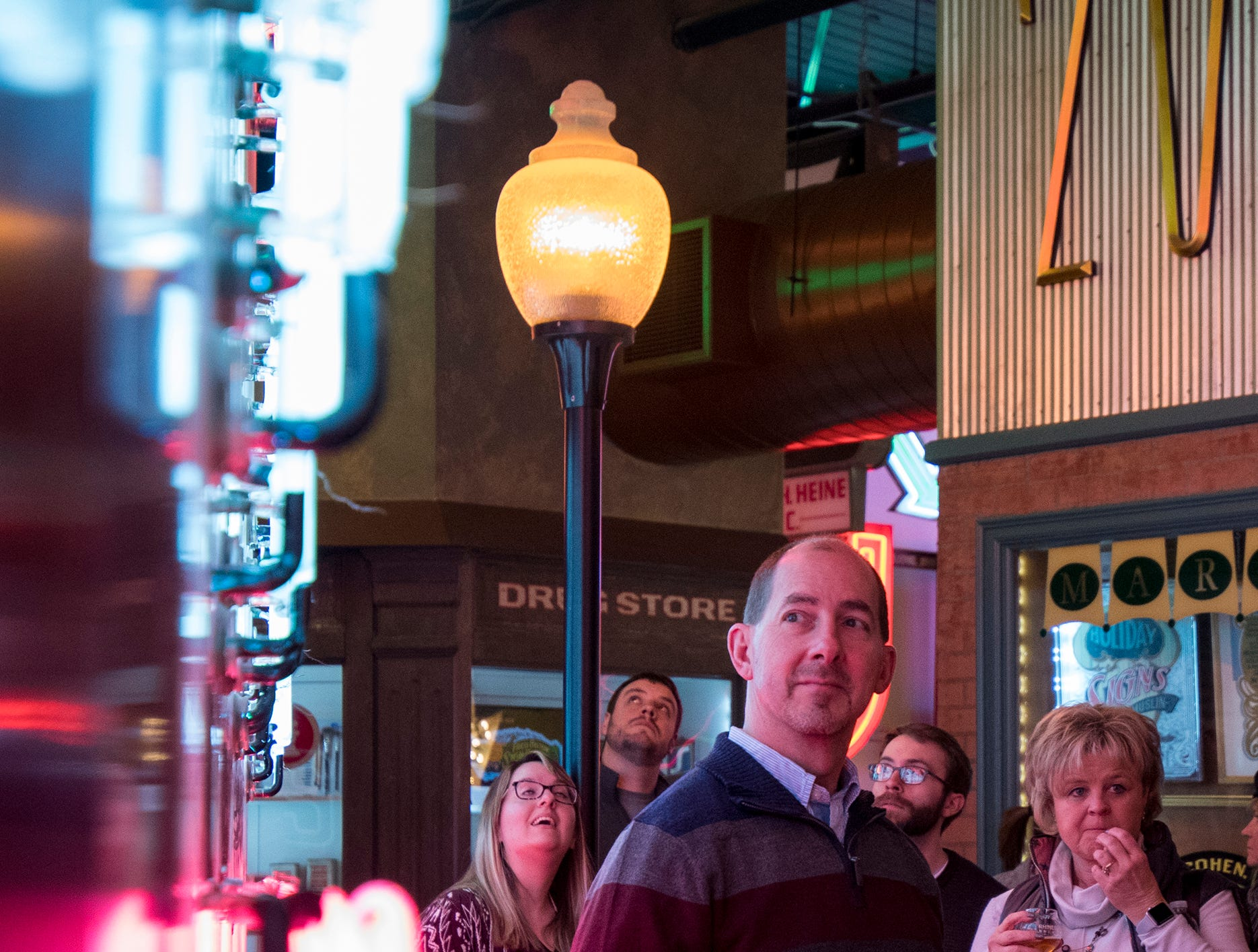Jeff Wolfe of Dayton checks out a giant neon McDonalds sign during Signs and Suds at the American Sign Museum Thursday, January 24, 2019 in Cincinnati, Ohio.