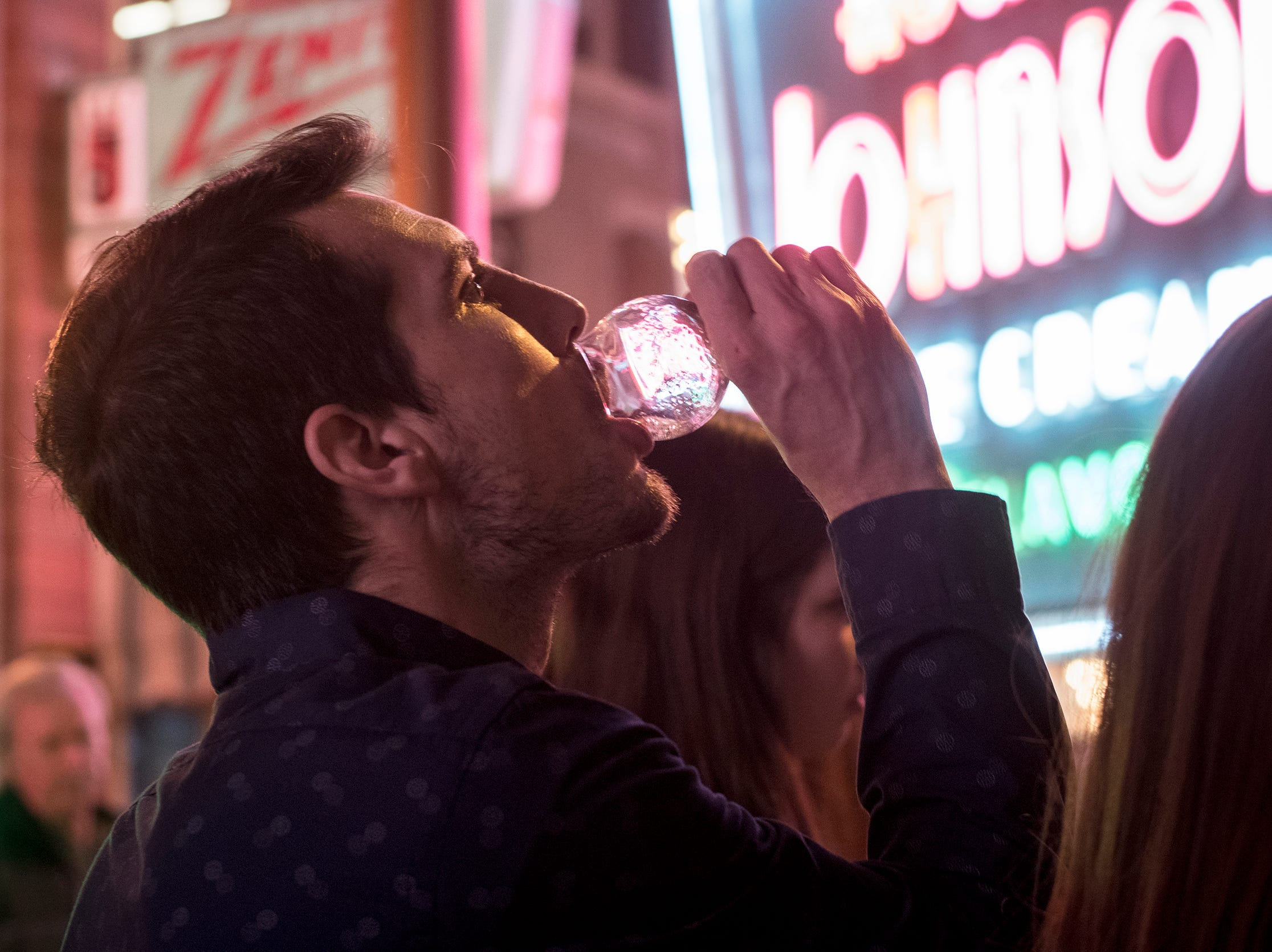 Alex Dieterle of Mumford Heights finishes a glass of Rhinegeist beer during Signs and Suds at the American Sign Museum Thursday, January 24, 2019 in Cincinnati, Ohio.