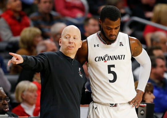 Cincinnati Bearcats head coach Mick Cronin talks with guard Trevor Moore (5) in the second half of the NCAA American Athletic Conference basketball game between the Cincinnati Bearcats and the Tulsa Golden Hurricane at Fifth Third Arena in Cincinnati on Thursday, Jan. 24, 2019. The Bearcats won 88-64.