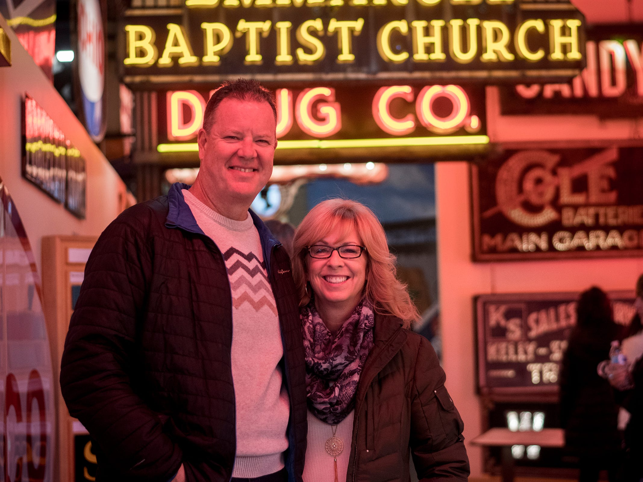 Bernie and Patty Small of East Price Hill attend Signs and Suds, featuring Rhinegeist beers at the American Sign Museum Thursday, January 24, 2019 in Cincinnati, Ohio.