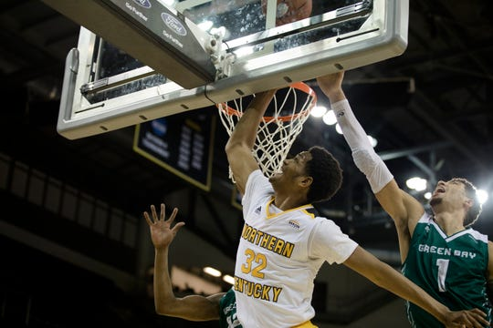 Northern Kentucky Norse forward Dantez Walton (32) lays the ball up as Green Bay Phoenix guard Sandy Cohen III (1) attempts to block it during the NCAA men's basketball game between Northern Kentucky Norse and Green Bay Phoenix on Thursday, Jan. 24, 2019, at BB&T Arena at Northern Kentucky University.