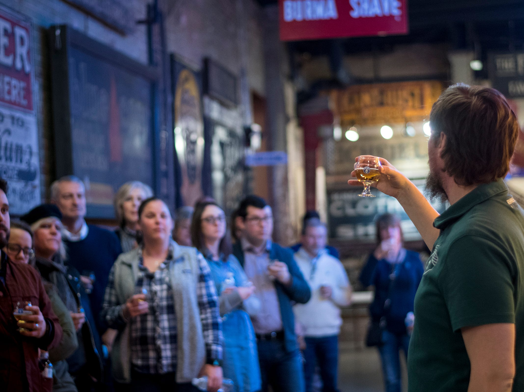 TJ DiNino tells guests about one of the Rhinegeist beers featured at Signs and Suds at the American Sign Museum Thursday, January 24, 2019 in Cincinnati, Ohio.