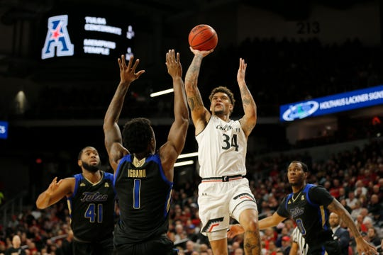 Cincinnati Bearcats guard Jarron Cumberland (34) shoots a jumper in the first half of the NCAA American Athletic Conference basketball game between the Cincinnati Bearcats and the Tulsa Golden Hurricane at Fifth Third Arena in Cincinnati on Thursday, Jan. 24, 2019. The Bearcats led 39-28 at halftime.