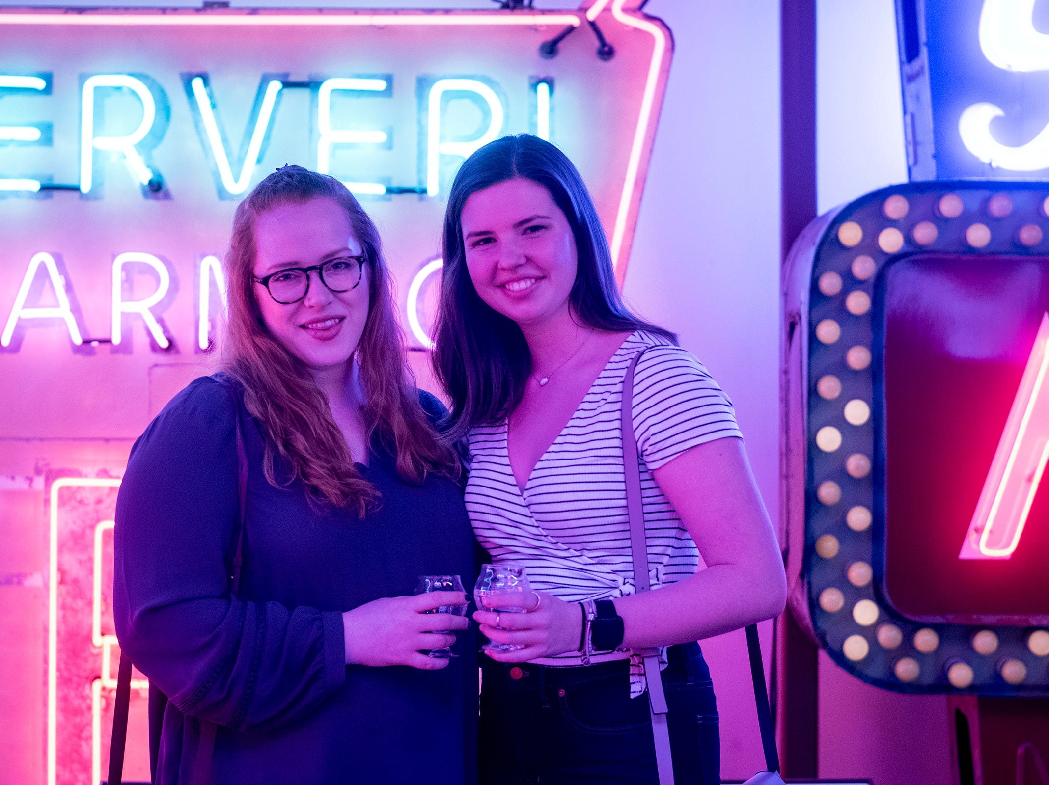 Rachel Serafin and and Brooke Long of Clifton attend Signs and Suds, featuring Rhinegeist beers at the American Sign Museum Thursday, January 24, 2019 in Cincinnati, Ohio.