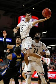Cincinnati Bearcats guard Cane Broome (15) leaps to the basket for a layup in the first half of the NCAA American Athletic Conference basketball game between the Cincinnati Bearcats and the Tulsa Golden Hurricane at Fifth Third Arena in Cincinnati on Thursday, Jan. 24, 2019. The Bearcats led 39-28 at halftime.