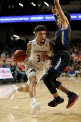 Cincinnati Bearcats guard Jarron Cumberland (34) drives into the paint in the first half of the NCAA American Athletic Conference basketball game between the Cincinnati Bearcats and the Tulsa Golden Hurricane at Fifth Third Arena in Cincinnati on Thursday, Jan. 24, 2019. The Bearcats led 39-28 at halftime.