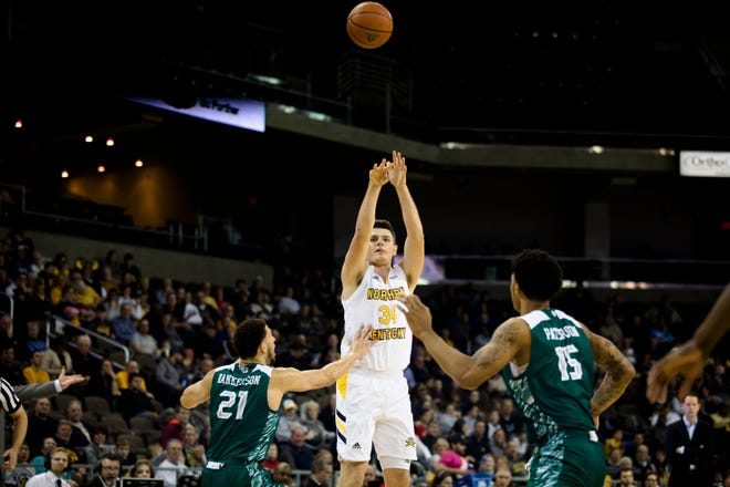 Northern Kentucky Norse forward Drew McDonald (34) hits a 3-pointer over Green Bay Phoenix guard Kameron Hankerson (21) during the NCAA men's basketball game between Northern Kentucky Norse and Green Bay Phoenix on Thursday, Jan. 24, 2019, at BB&T Arena at Northern Kentucky University.