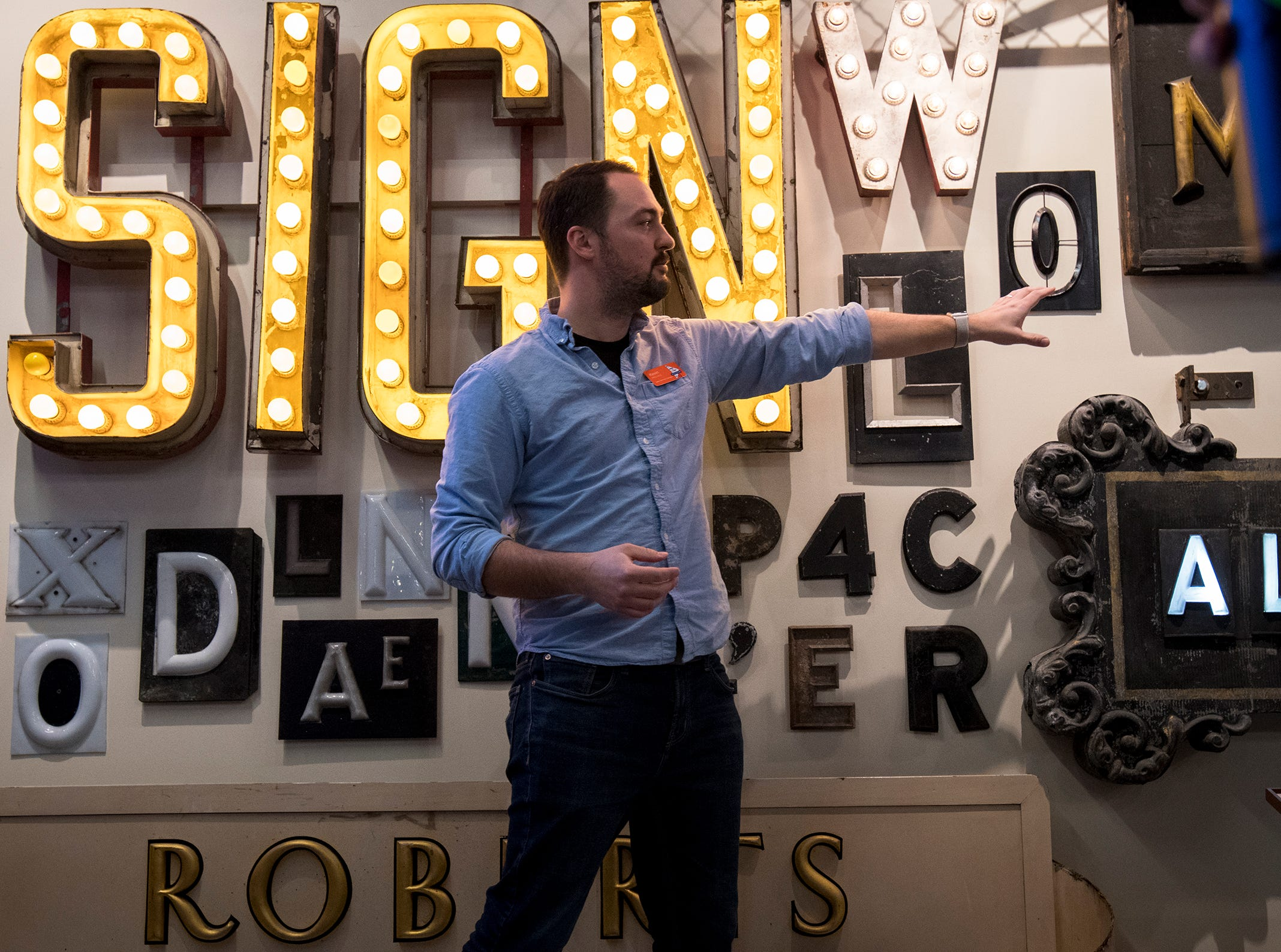 Kevin Wallace leads guests on a private tour through the American Sign Museum during Signs and Suds, a collaboration with Rhinegeist, Thursday, January 24, 2019 in Cincinnati, Ohio.