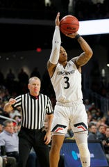 Cincinnati Bearcats guard Justin Jenifer (3) shoots from three point range in the first half of the NCAA American Athletic Conference basketball game between the Cincinnati Bearcats and the Tulsa Golden Hurricane at Fifth Third Arena in Cincinnati on Thursday, Jan. 24, 2019. The Bearcats led 39-28 at halftime.