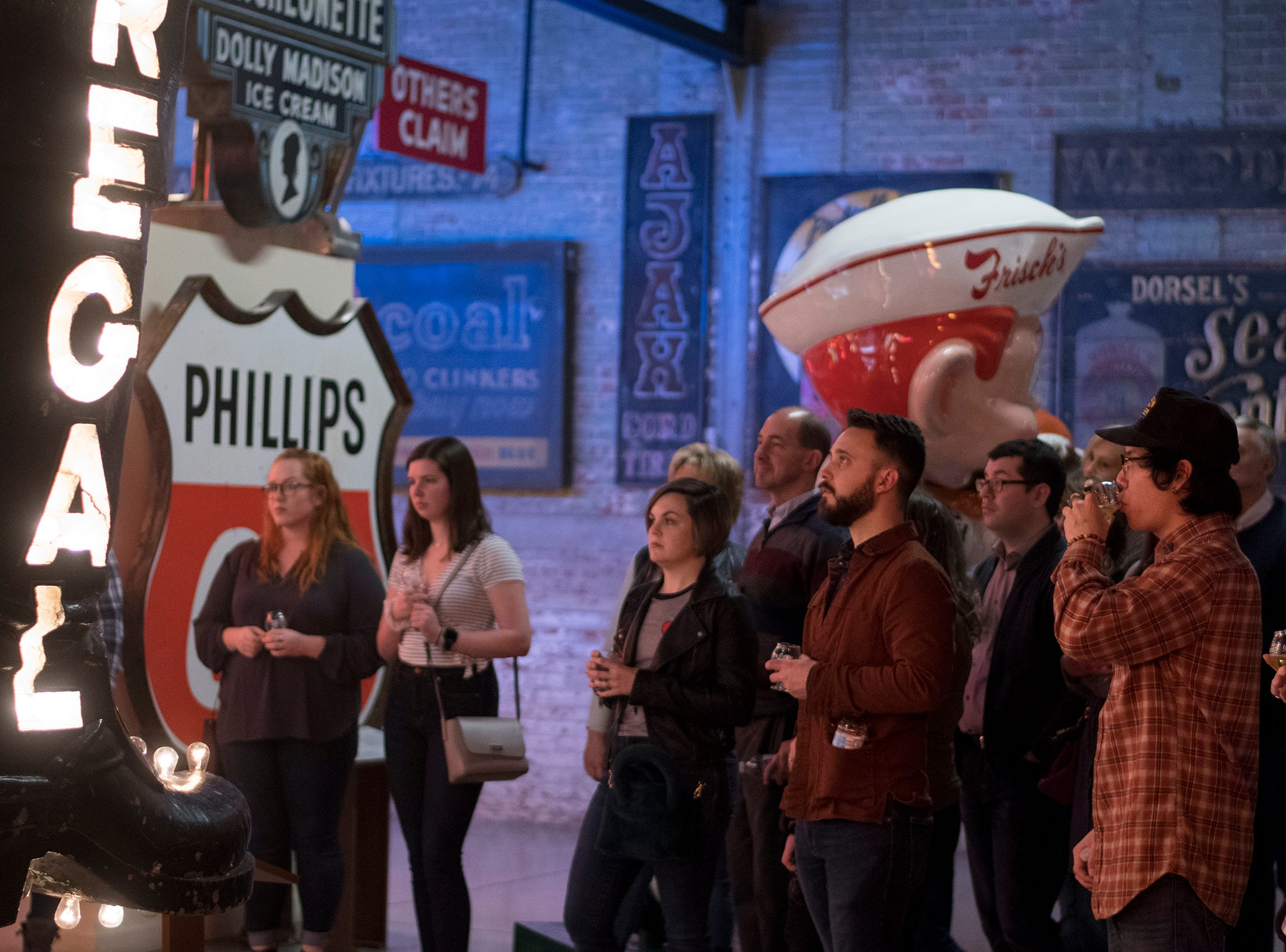 Guests get a private tour of the American Sign Museum while tasting some special Rhinegeist beers during Signs and Suds Thursday, January 24, 2019 in Cincinnati, Ohio.