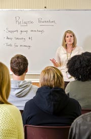 Michelle Pritchard, director of clinical services, Center for Addiction Treatment, leads a class of people with addiction.