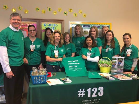 Stephen P. Zieniewicz, president & CEO, Saint Barnabas Medical Center (far left) wears green in observance of Maternal Health Awareness Day