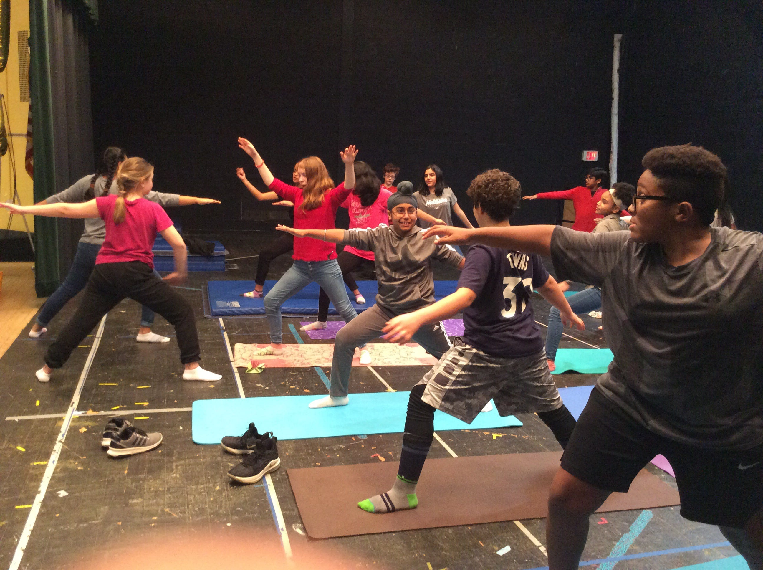 Middle School students learn about yoga.