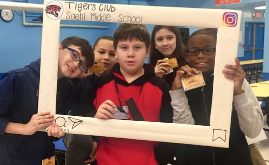 Students at a kickoff event for Soehl Middle School Tigers Club, when they learned that they were accepted into the special rewards club. From left to right: Camrin Blair, Derek Stash, Karol Kozak, Kyndra Green and Jodarsen Pierre.