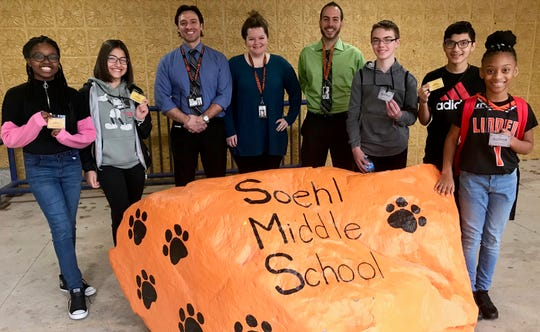 Soehl Middle School Principal Richard Molinaro, guidance counselor Caitlin Sanders, and social studies teacher Peter Citera with members of the Tigers Club showing their gold and platinum cards. From left to right: Courtney Mills, Jennifer Tavares, Joseph Fitz, Kris Ordonez and Cassidy Moore.