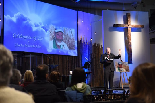 Jon Anenson, pastor of Lutheran Church of Hope in Des Moines, reads from the Bible on Jan. 25, 2019, during a memorial service for Charles Childs, a member of the homeless community killed at the beginning of the year.