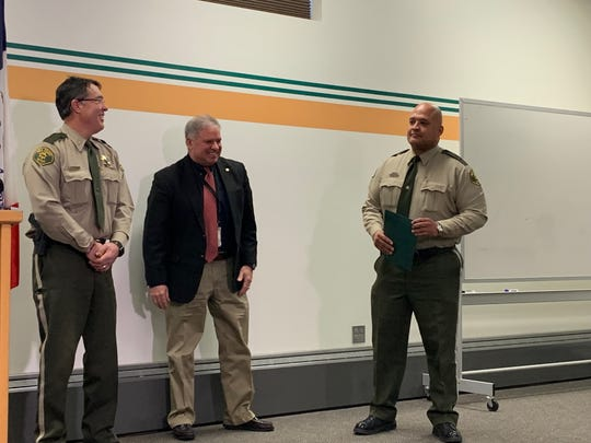 """Robert """"Bob"""" Stanton, Polk County sheriff's first black chief, stands to the right of fellow Chief Tim Krum, far left, and Vic Munoz, chief deputy of the sheriff's office, Thursday, Jan. 24, 2019 at the Polk County Jail"""