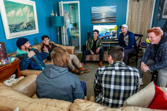 "Pop artist Quinn XCII (in aqua hoodie at left) talks about his new album, ""From Michigan With Love,"" with  fans during a listening party at John Adamkiewicz's house in Dearborn Heights, Mich. on Friday, Jan. 25, 2019. Adamkiewicz, who won the listening party through a contest, invited his high school friends and fellow Quinn fans."