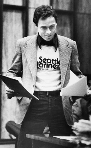Accused serial killer Ted Bundy wears a Seattle Mariners T-shirt in court in Miami, July 5, 1979, as he presented is own motions and made a request for a typewriter in his Dade County jail cell.