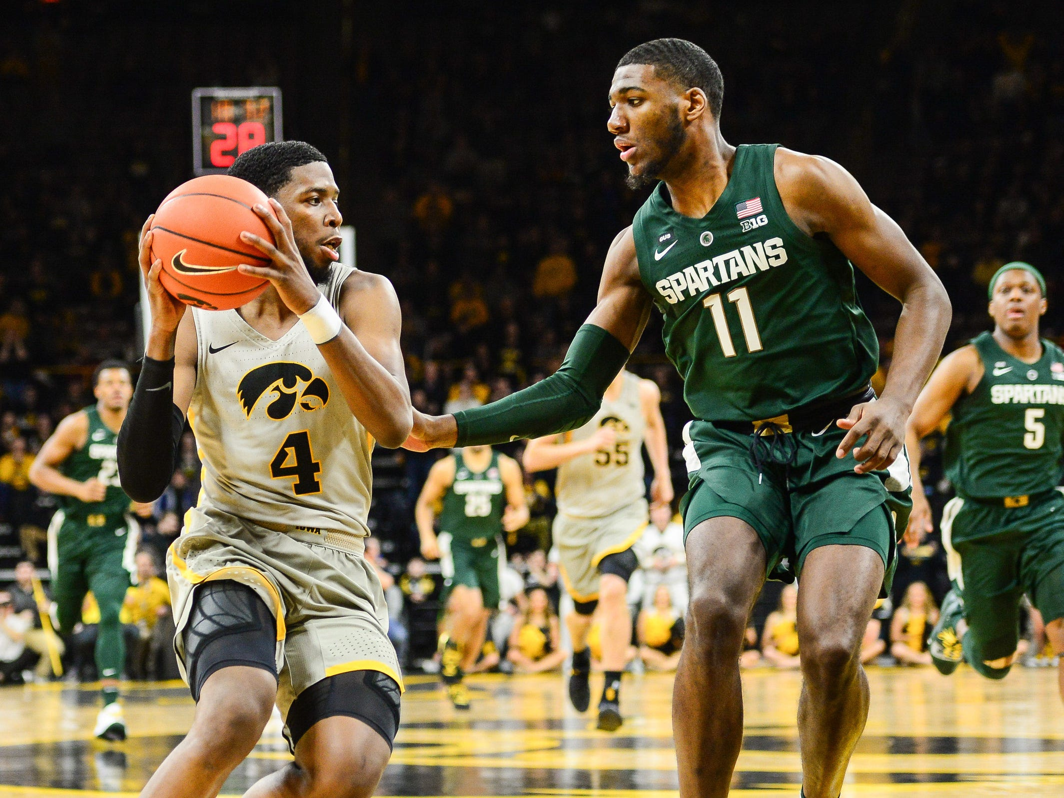 Iowa guard Isaiah Moss drives against Michigan State forward Aaron Henry during the first half Thursday, Jan. 24, 2019, in Iowa City, Iowa.