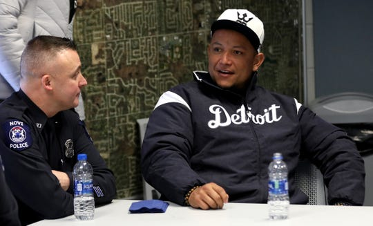 Novi police detective Mike Bender, left, talks with Tigers first baseman Miguel Cabrera.