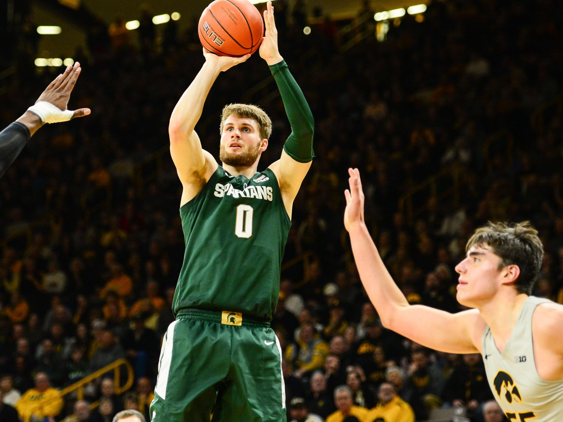 Michigan State's Kyle Ahrens shoots against Iowa in the second half in Iowa City, Iowa on Thursday, Jan. 24, 2019.