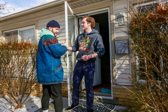 "Pop artist Quinn XCII, left, greets John Adamkiewicz, 19, who won a listening party through a contest to hear the new album ""From Michigan With Love"" at his home in Dearborn Heights, Mich. on Friday, Jan. 25, 2019."