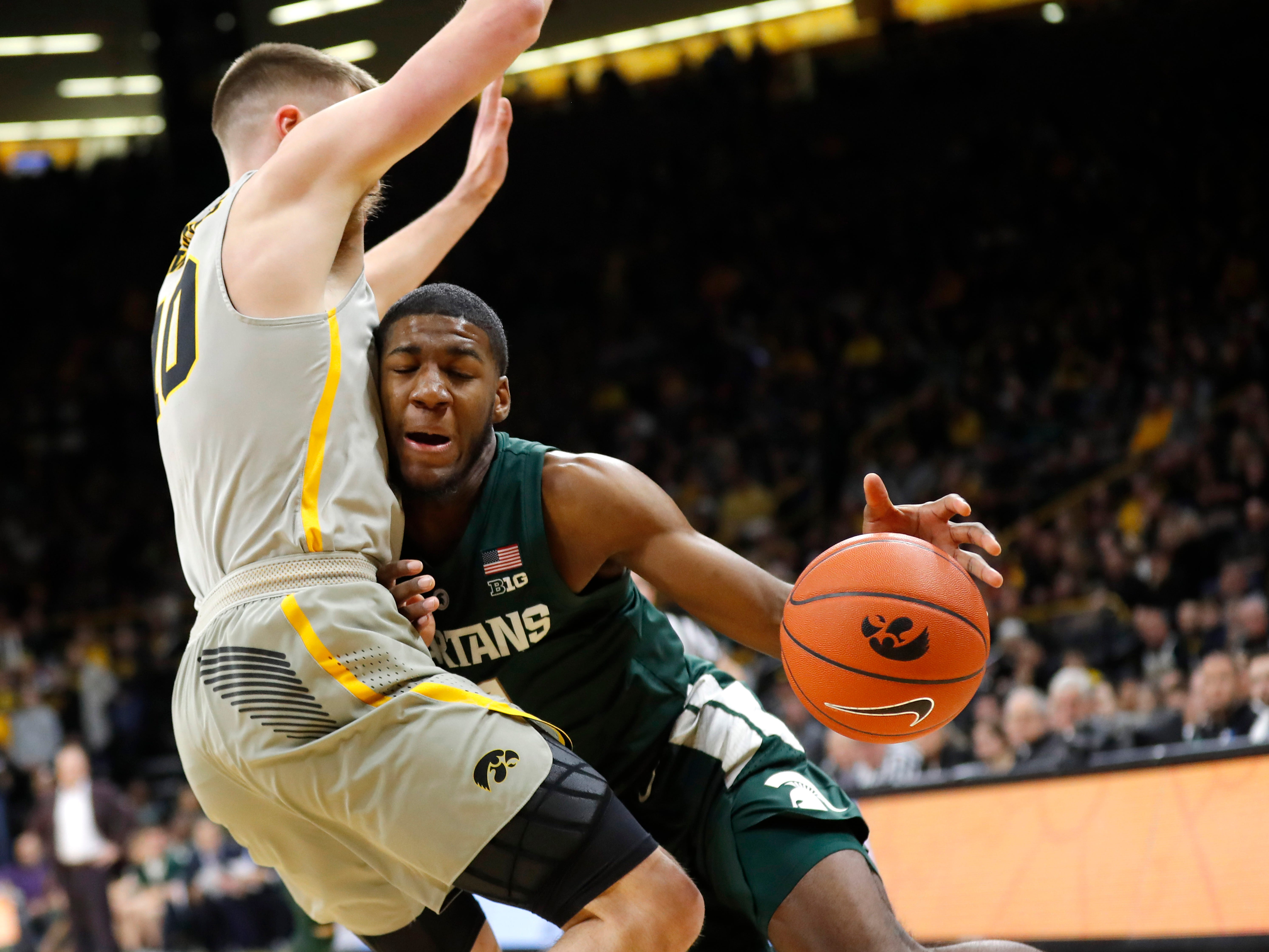 Michigan State forward Aaron Henry drives against Iowa guard Joe Wieskamp during the first half Thursday, Jan. 24, 2019, in Iowa City, Iowa.