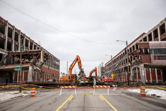 A crew tears down the overpass that collapsed at the Packard Plant in Detroit on Thursday, Jan. 24, 2019.