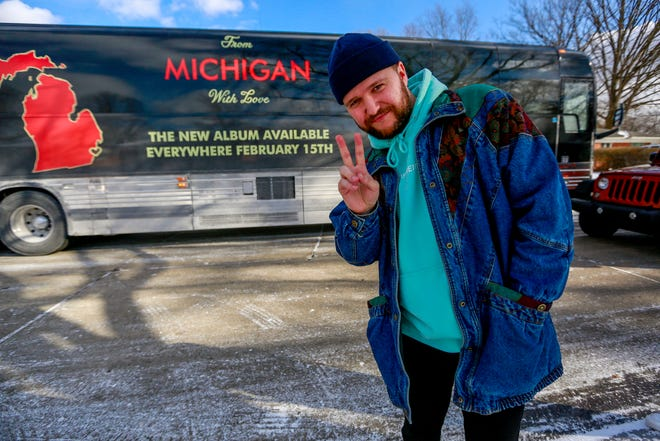 Quinn XCII poses in front of his tour bus on Jan. 25, 2019.