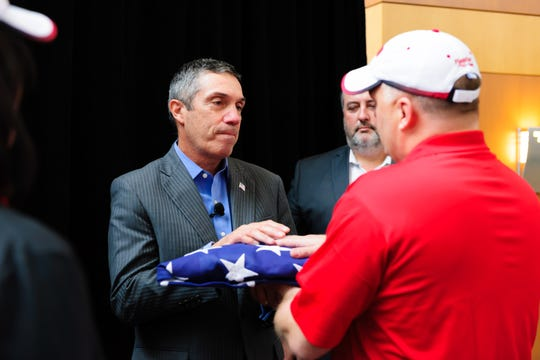 Flagstar Bank President and CEO Sandro DiNello commemorates Veterans Day in 2018 with employees of the bank who are veterans.