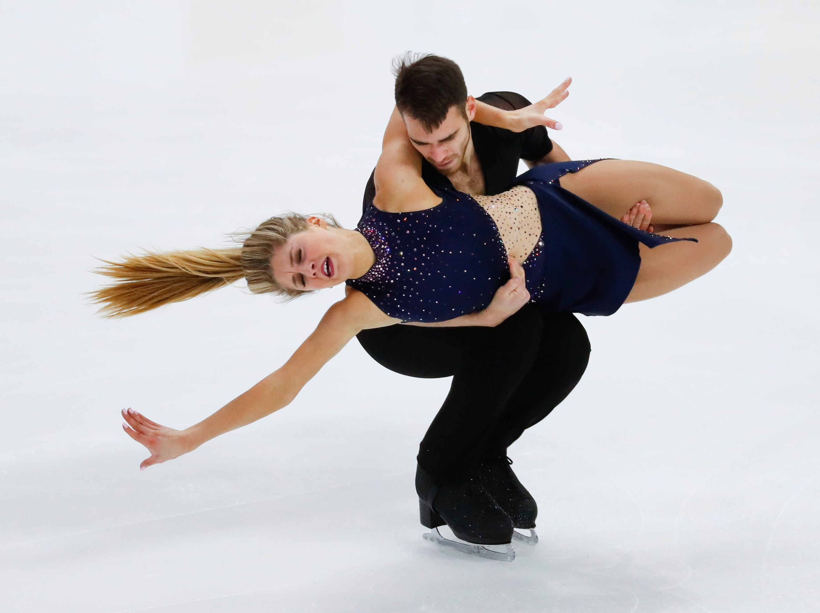 Lydia Erdman and Yuri Vlasenko perform their rhythm dance program at the U.S. Figure Skating Championships.
