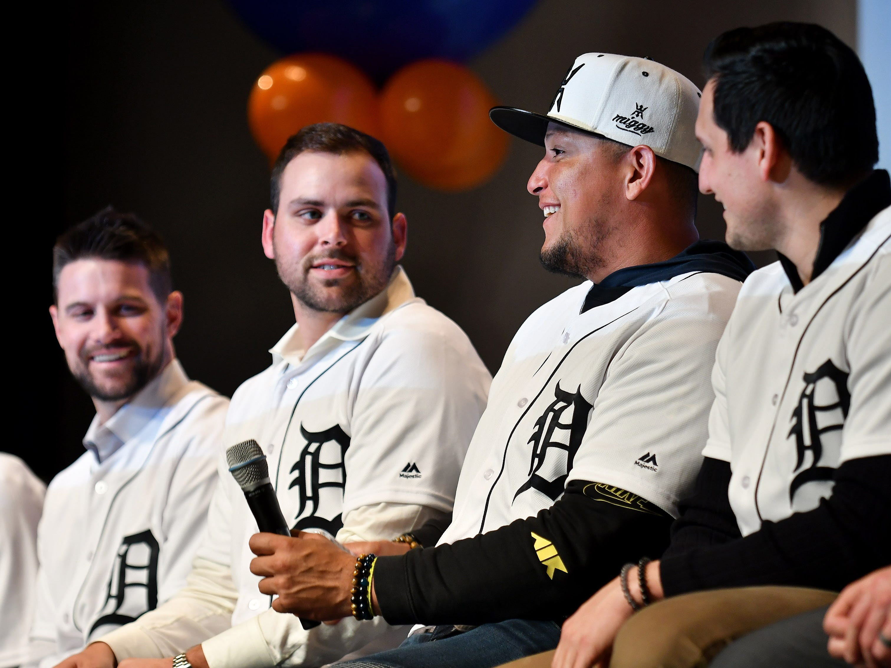 Tigers' Michael Fulmer, left, looks over while Miguel Cabrera smiles and pauses while answering a question as to how many home runs he has hit in his career (465) at a kids rally at Novi High School.