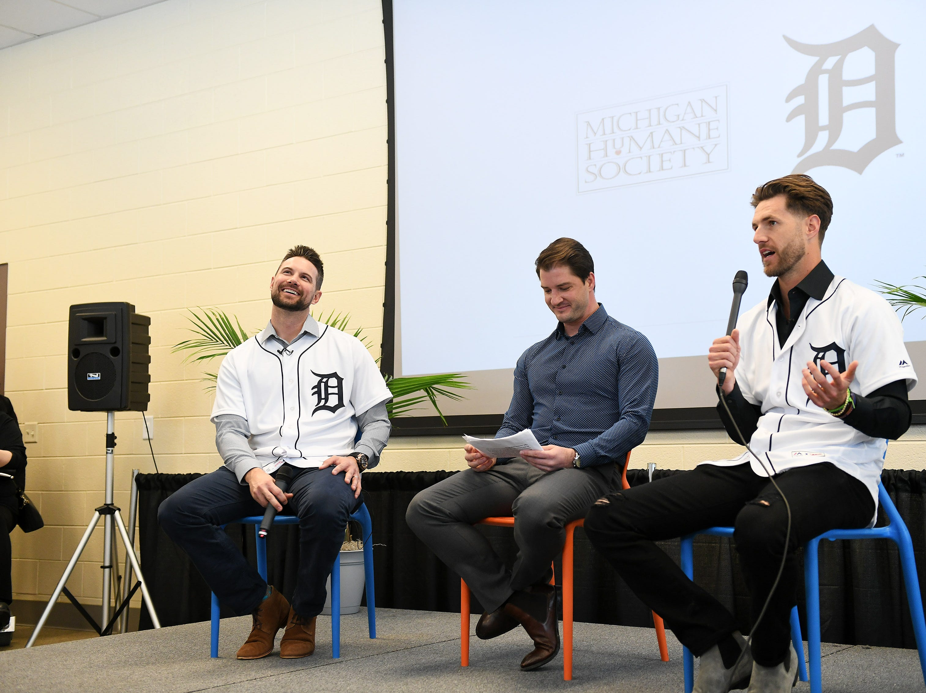 Tigers' Jordy Mercer, left, and Shane Greene, right, answer questions from the people gathered, moderated by Johnny Kane from Fox Sports Detroit, center, at the Michigan Humane Society.