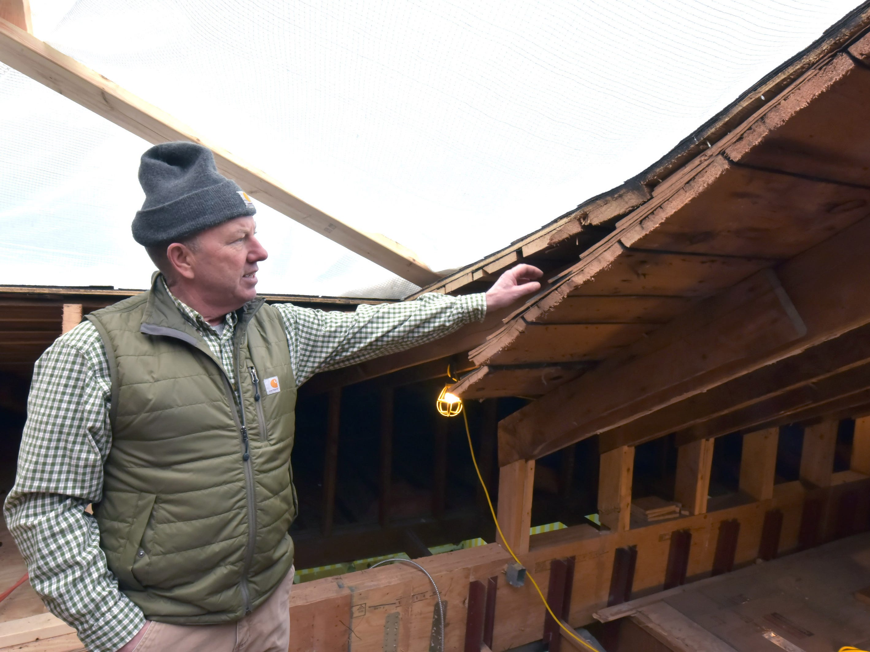 Andy McGreevy, construction project manager at Mackinac Island's iconic Grand Hotel, shows the original roofline on the fourth floor.