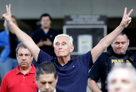 Former campaign adviser for President Donald Trump,  Roger Stone walks out of the federal courthouse following a hearing, Friday, Jan. 25, 2019, in Fort Lauderdale, Fla.