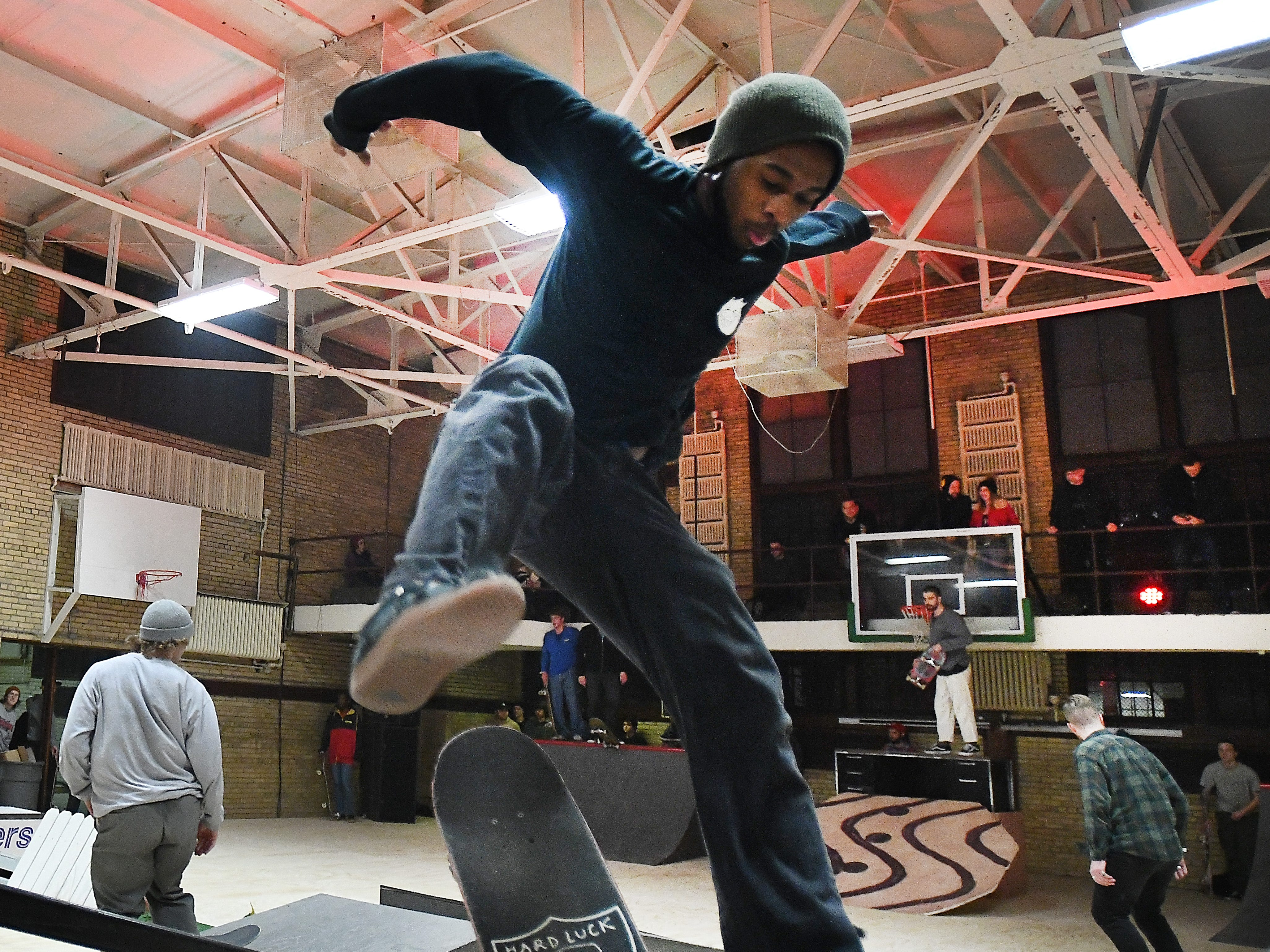 Keviyan Richardson of Detroit flips his board over the rail in the pop-up skateboard course at the House of Vans pop-up at Jefferson School.