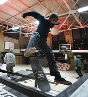 Keviyan Richardson of Detroit flips his board over the rail in the pop-up skateboard course.