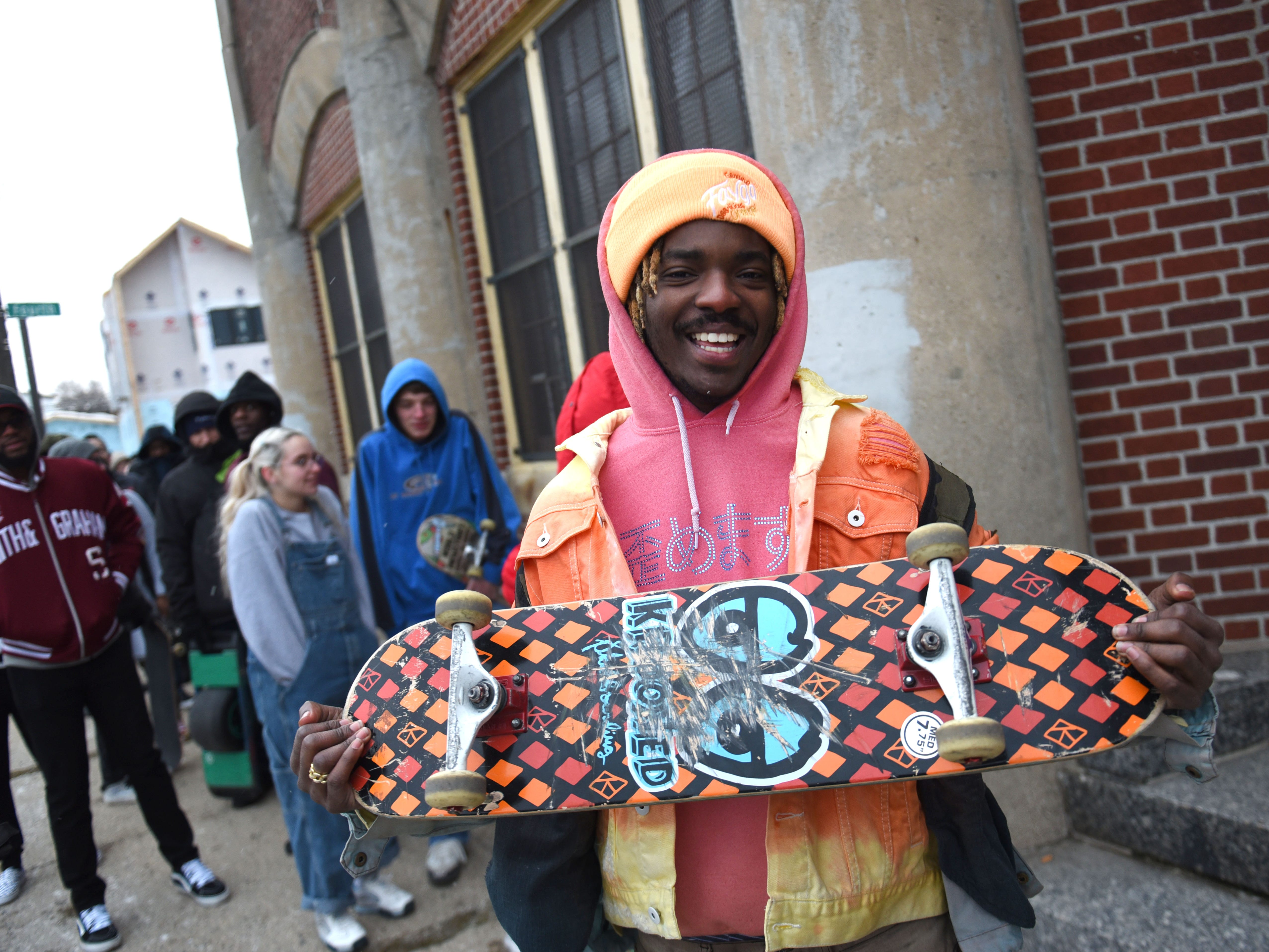 Christopher Dunn of Detroit shows off his board as he waits in line to enter the House of Vans pop-up event in Detroit.