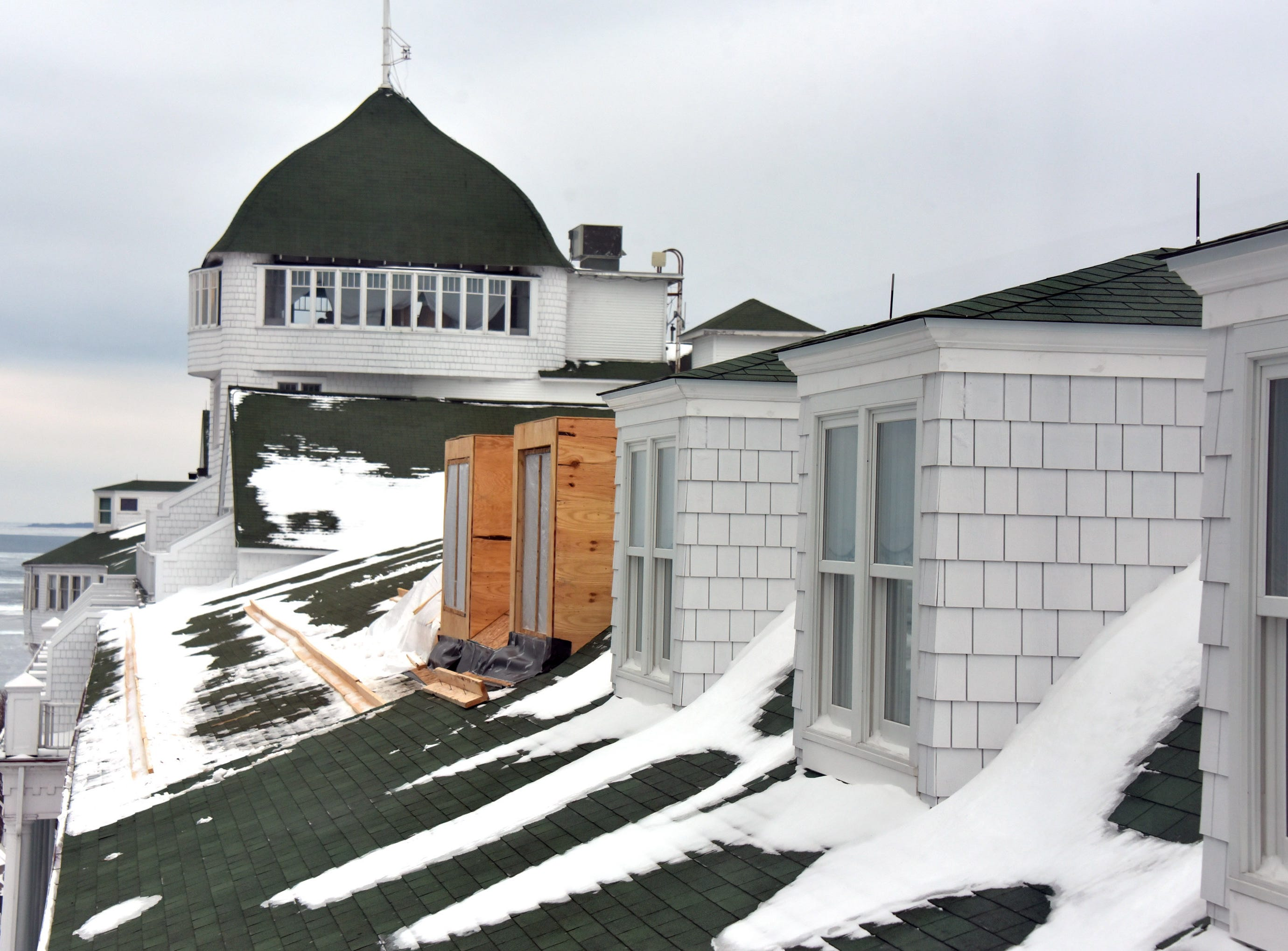 New dormers are appearing on the fourth floor roof at Mackinac Island's iconic Grand Hotel.