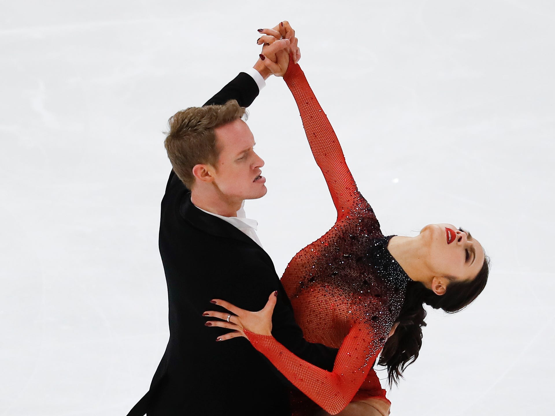Taking second place, Madison Chock and Evan Bates perform their rhythm dance program at the U.S. Figure Skating Championships, Friday, Jan. 25, 2019, in Detroit.