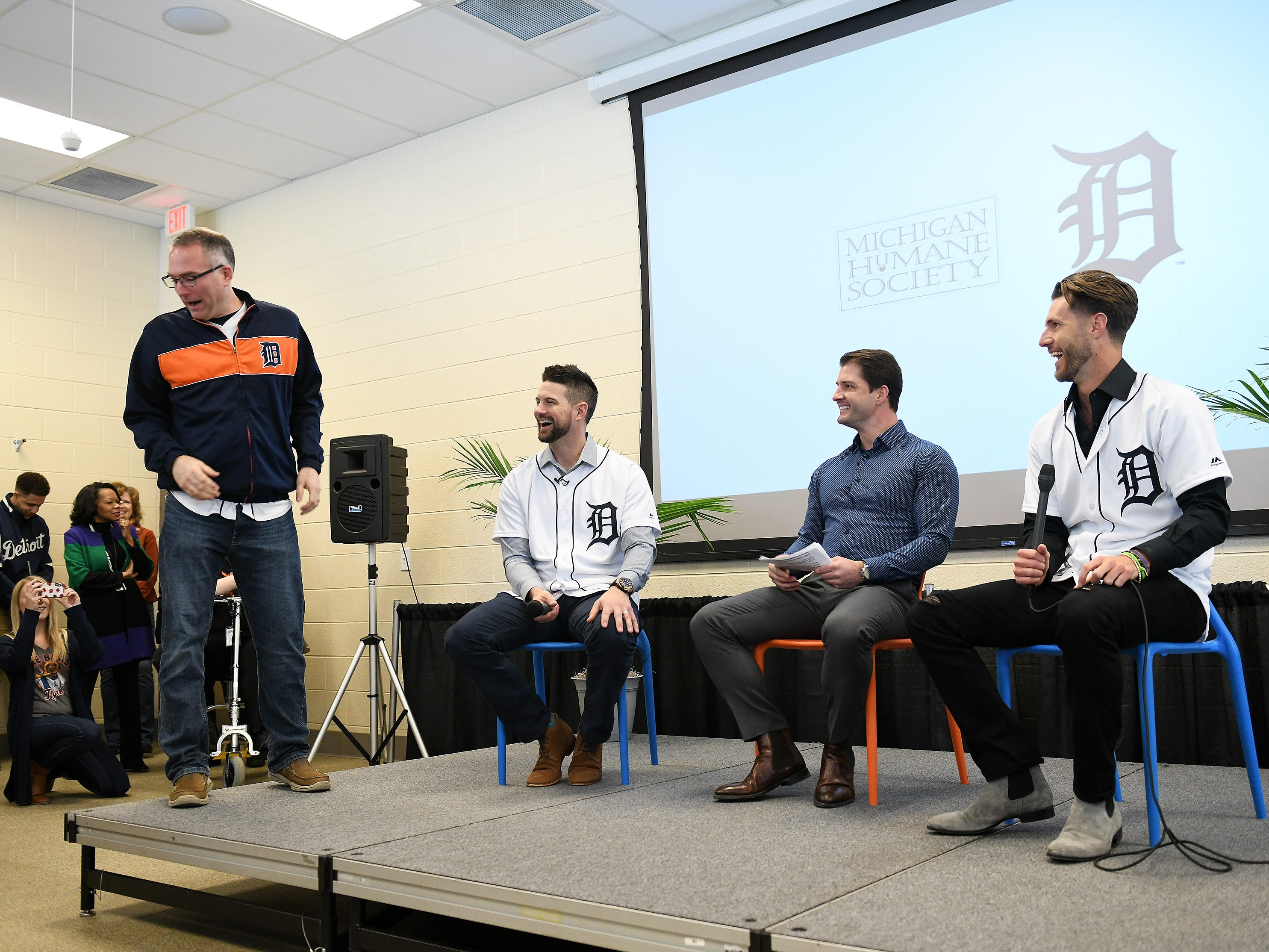 From left, Michigan Humane Society CEO Matt Pepper, Tigers' Jordy Mercer, Johnny Kane from Fox Sports Detroit and Tigers' Shane Greene at the Michigan Humane Society.