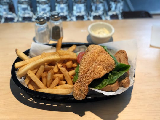 The catfish sandwich at Fusion Flare is served with french fries.