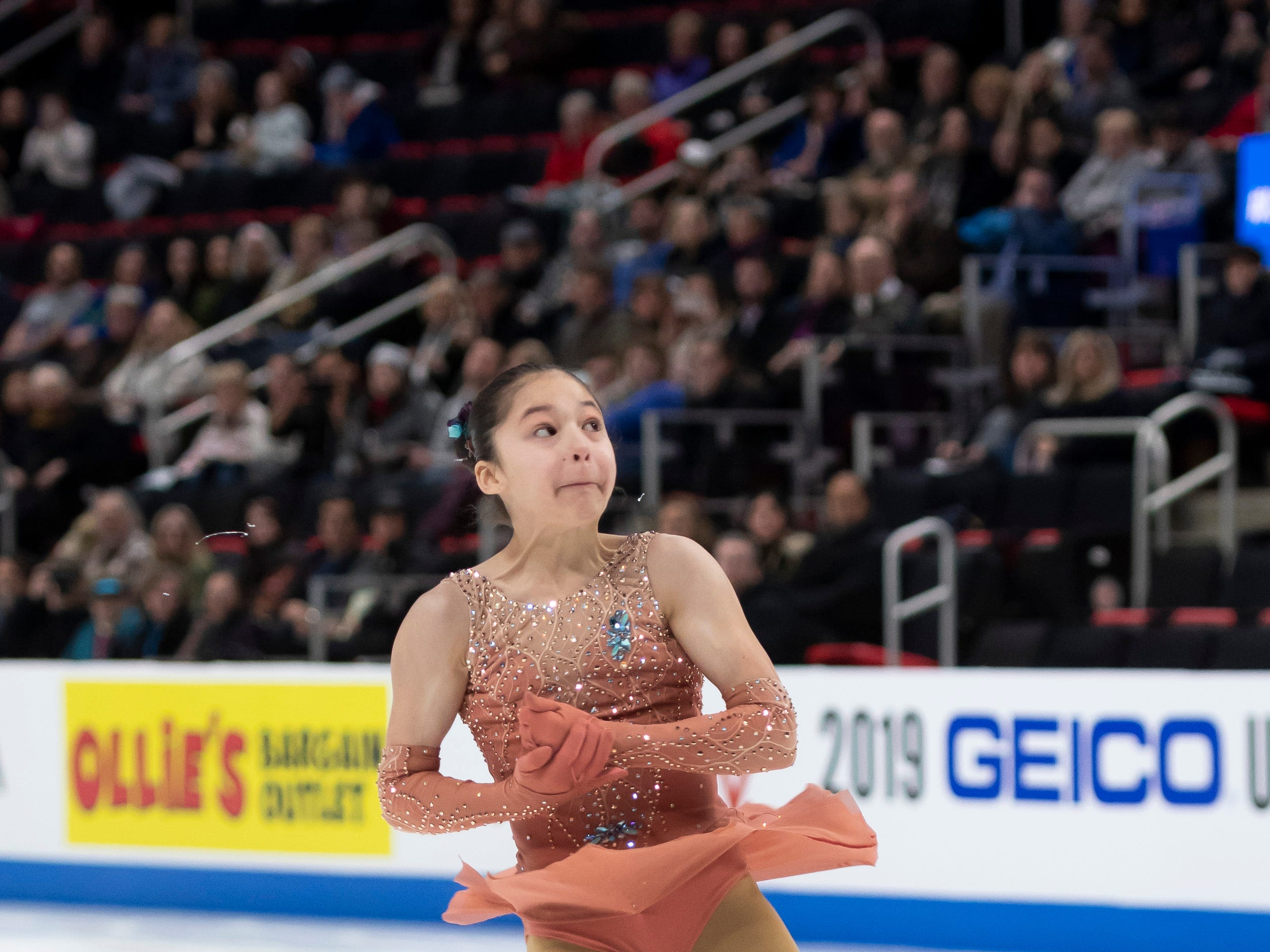 Thirteen-year-old Alysa Liu completes a triple-axle while competing in the ladies short program. Liu become the youngest American in history to make the jump.