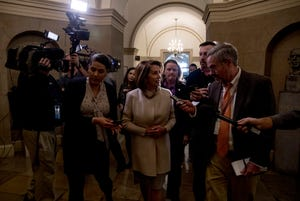 House Speaker Nancy Pelosi of Calif. speaks to members of the media as she arrives on Capitol Hill in Washington, Friday, Jan. 25, 2019.