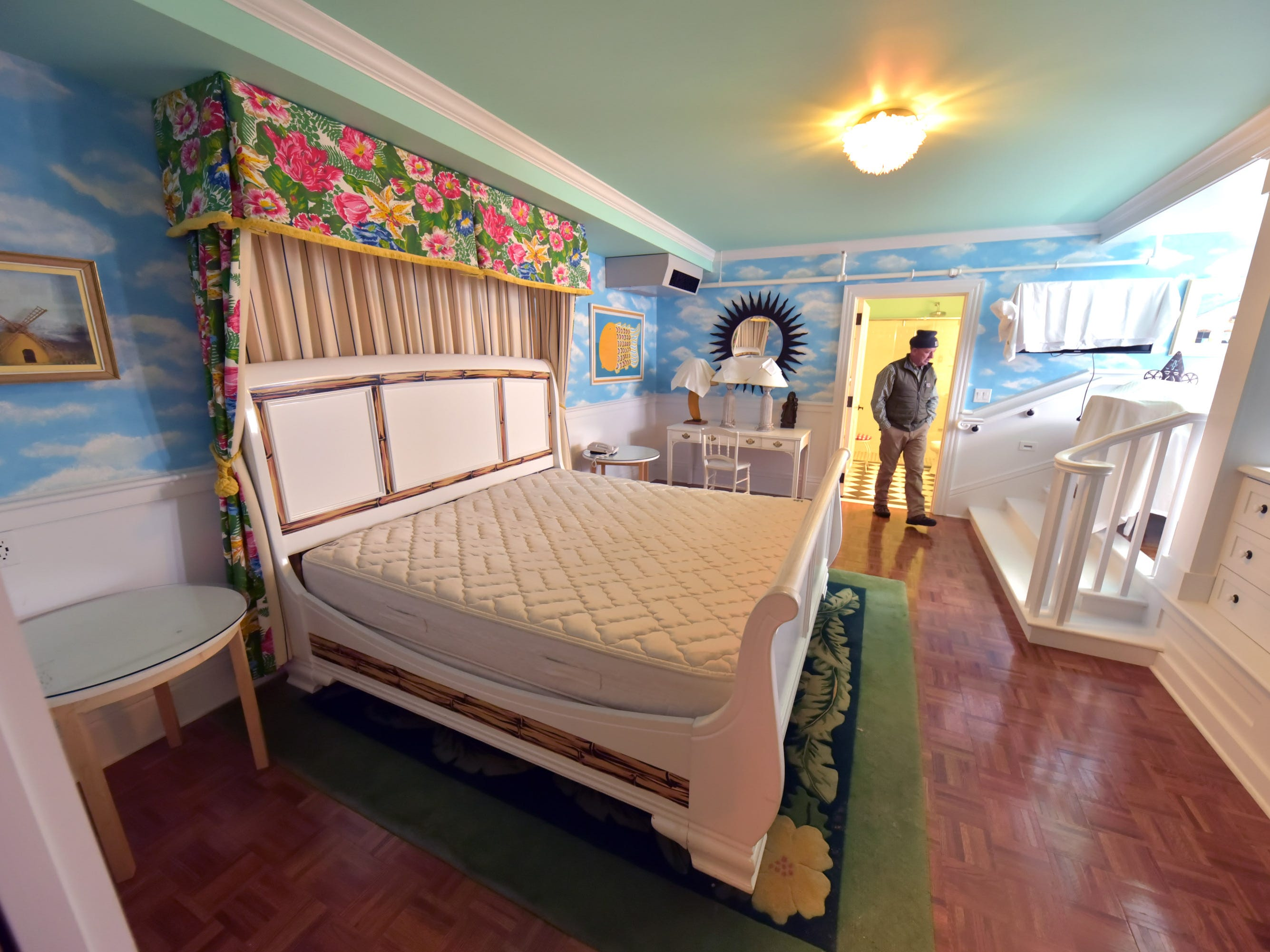 A bedroom in the Cupola Suites project at Mackinac Island's iconic Grand Hotel is inspected by Andy McGreevy, construction project mananger.